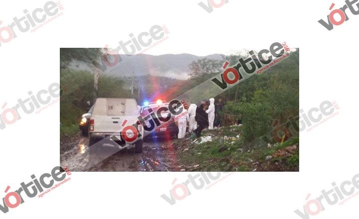 Encuentran cadáver acribillado dentro de una camioneta
