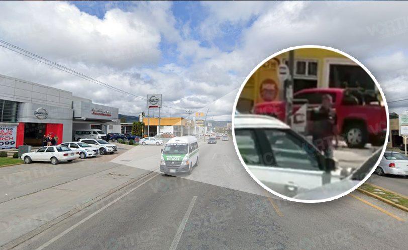 Persecución termina en balazos frente a conocida agencia de autos