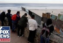 Migrant caravan groups begin arriving at US border