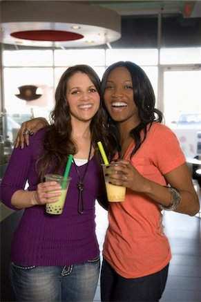 619-08591153 © Masterfile Royalty-Free Model Release: Yes Property Release: Yes Smiling friends drinking bubble tea in cafe