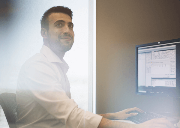 healthcare professional in front of computer screen