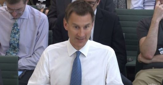 The grinning Jeremy Hunt.