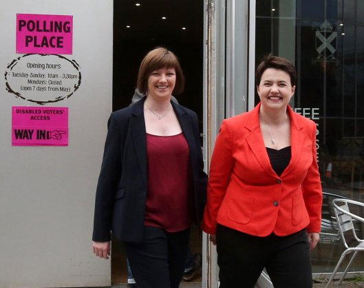 Ruth Davidson makes her way to a polling station in Edinburgh with partner Jen Wilson [Image: Andrew Milligan/PA Wire].