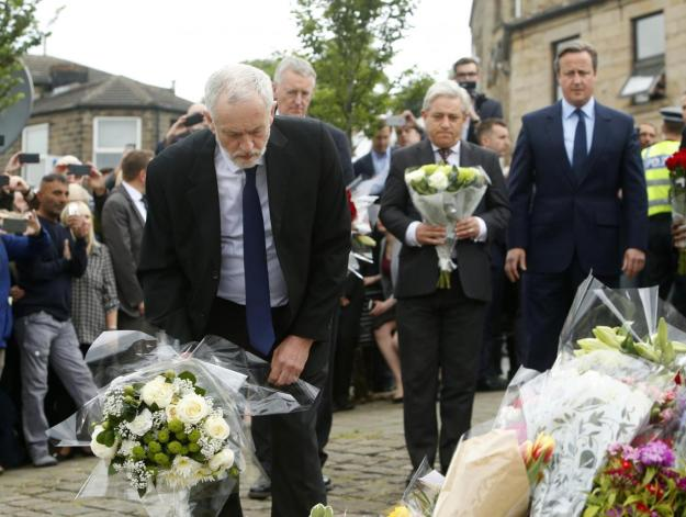 Labour Party leader Jeremy Corbyn lays flowers while Commons Speaker John Bercow and Prime Minister David Cameron look on in Birstall, West Yorkshire, after Labour MP Jo Cox was shot and stabbed to death in the street [Image: PA images].