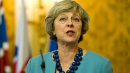 Theresa May has launched a campaign against slavery, without acknowledging that her government actively supports other forms of bondage [Image: AFP].