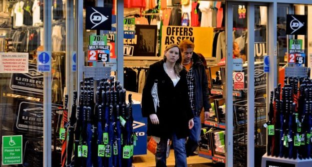 Shoppers leaving a Sports Direct store [Image: Martin Pettitt/photopin cc].