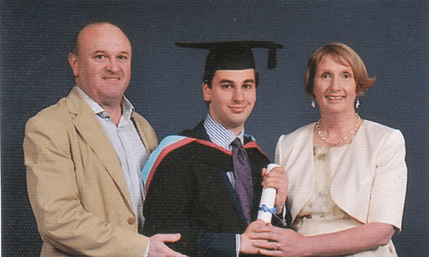 Elliott Johnson at his graduation from Nottingham University, with his parents, Ray and Alison [Image: Family Photo].
