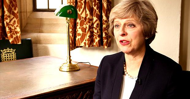 Theresa May telling daughters they should listen to their fathers on the Women2Win video.