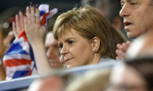 Nicola Sturgeon watches Andy Murray in Glasgow on Sunday. Her party believes a single market guarantee would boost support for independence [Image: Robert Perry/EPA].