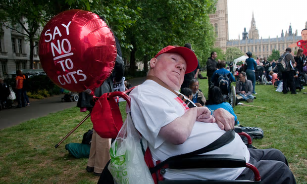 Disabled people protest about cuts to benefits and services [Image: Alamy Stock Photo].