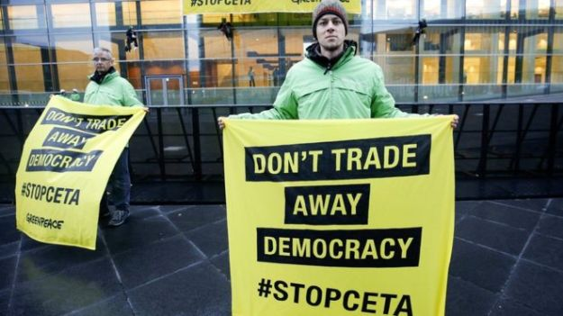 Protesters from Greenpeace with #stopceta banners [Image: BBC].