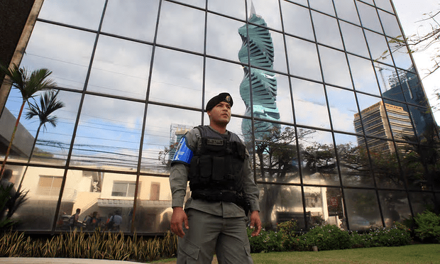 A police officer stands guard outside the headquarters of Mossack Fonseca, in Panama City [Image: Alejandro Bolivar/EPA].