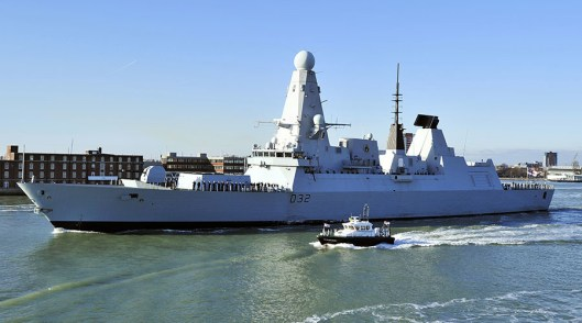 British Royal Navy destroyer HMS Daring. The boat next to it is probably on its way to tug it into the shipyard for more repairs [Image: Glyn Kirk/AFP].