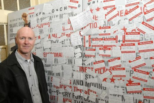 Paul Laverty at the Cameo Cinema in Edinburgh in front of the wall of messages [Image: Daily Record].