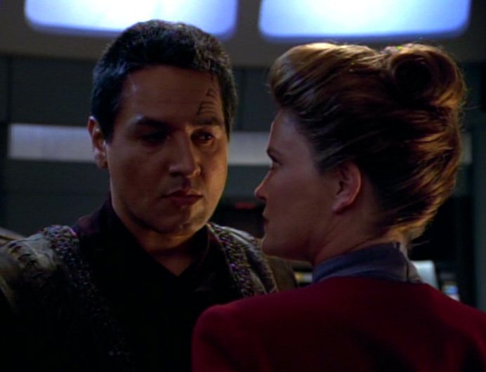 Janeway and Chakotay staring intently at each other. Personal space is not happening right now.