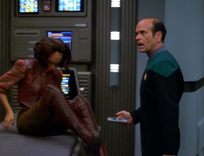 B'Elanna heaves herself off a biobed, revealing her red leather thigh-high boots.