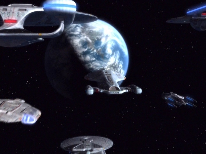 In the last shot of the series, Voyager is escorted to Earth.