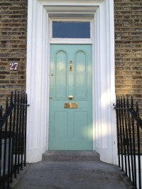 A mint green, late Georgian front door in north London