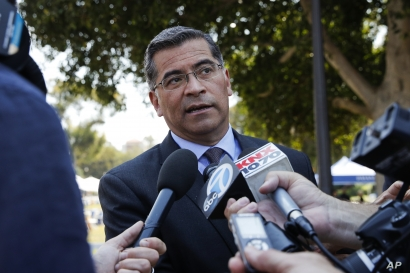 FILE - California Attorney General Xavier Becerra talks to reporters after a news conference at University of California, Los Angeles, Aug. 2, 2018.