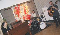 Vanessa, Sylvia Cuenca (drums), and Yutaka Hashimoto (guitar) sound-check at O-Studio in Tsuyama; August 21. 2005