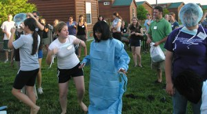 "Annie Chih is the model in the ""dress your partner in PPE"" Science Olympics event at Worlds of Fun amusement park in Kansas City with scholars from the Oklahoma State and Kansas State VRSPs."