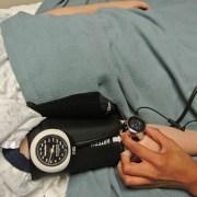 Odessa Johnson taking blood pressure