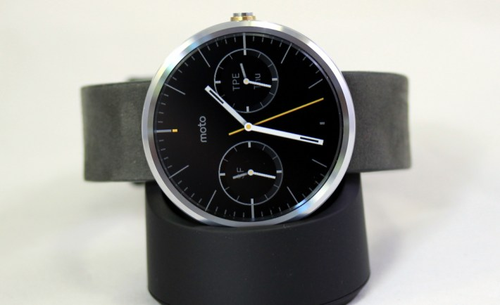 Moto 360 in its inductive wireless charging base