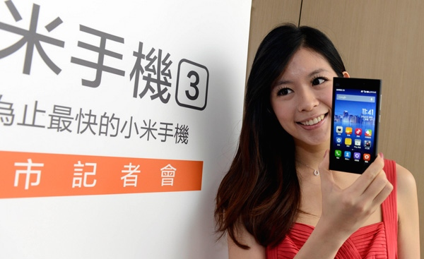 A model holding a Xiaomi phone at a Xiaomi press conference in Taiwan