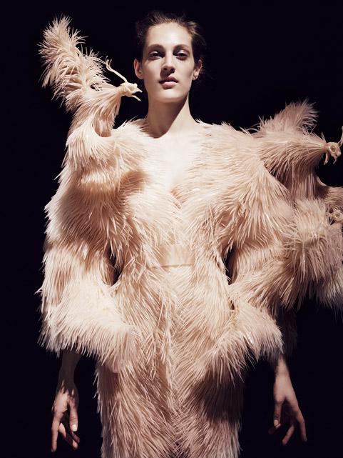 Iris van Herpen (Dutch, born 1984). Dress, fall/winter 2013–14. Silicon feather structure and moldings of bird heads on cotton base. Credit: Jean-Baptiste Mondino