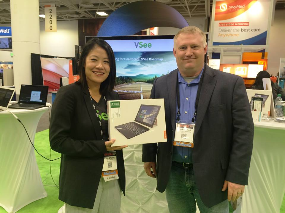 VSee VP of Product Management, Dr. Erika Chuang, with one of the lucky winners of a Lenovo tablet!
