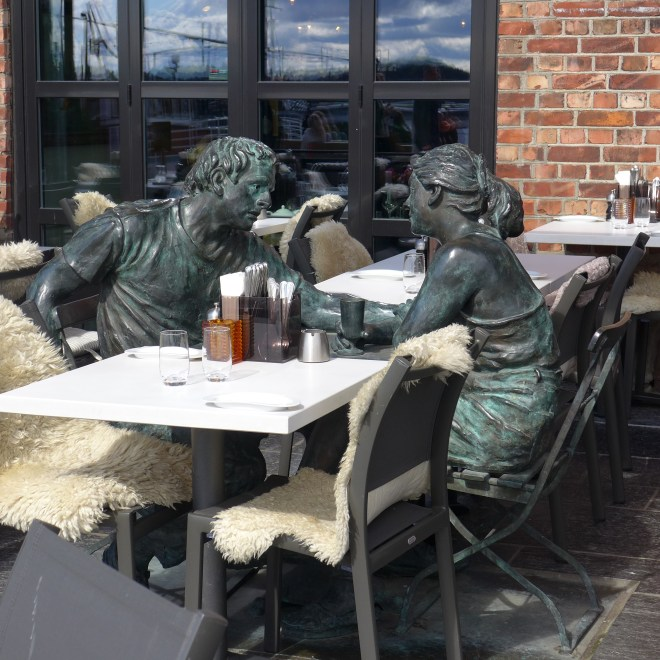 Seated in deep conversation at Aker Brygge.