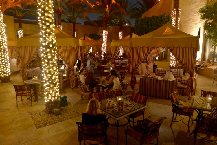 The exotic warm courtyard in the Arabian Court with live traditional music and shisha pipes. The Royal Mirage.