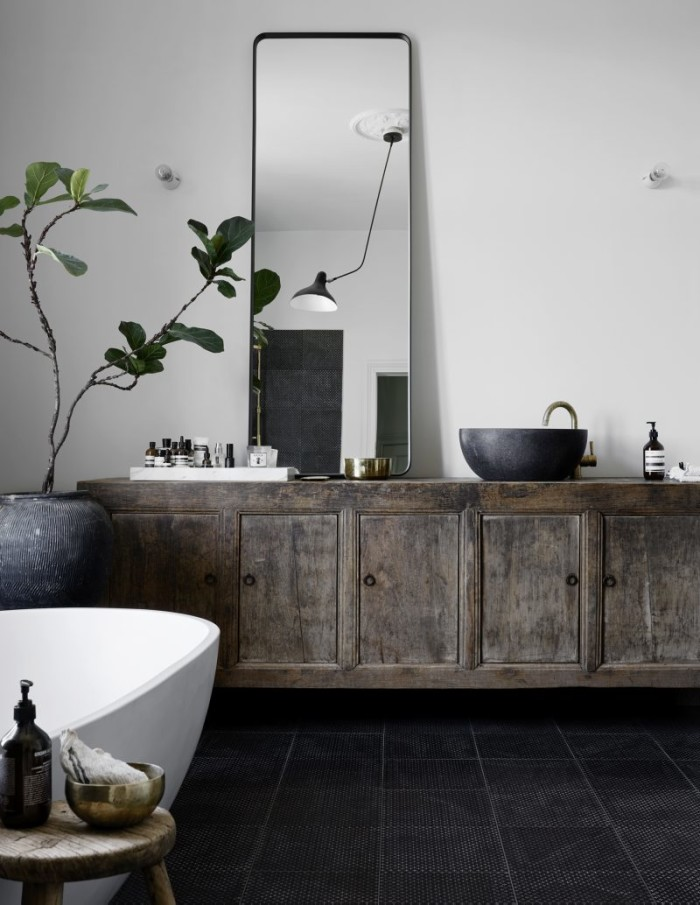 Bathroom with an antique Chinese cabinet, mirror from Norm Architects for Menu.