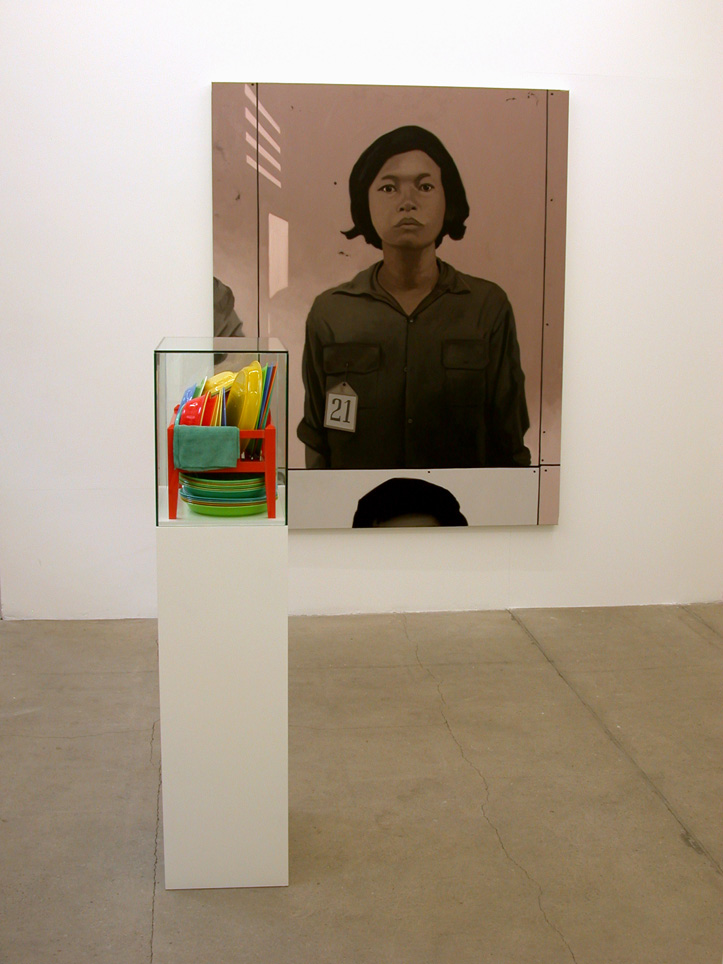 Exhibition Paradiso at Galerie Forsblom. Seen here Maraton, based on photographs in a Khmer Rouge concentration camp where prisoners like this young girl were photographed and catalogued before being tortured to death. The installation of plates and bowls that were found in a monastery represents hope after such a dark period in history. Photo: Tord Lund. V Söderqvist Blog.