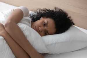 sad or depressed woman laying in bed
