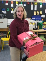 Mrs. Evelyn delivers the package each day!