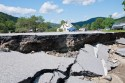 Floodwaters from Irene tore away sections of roadway on Route 100. such as this section in Lower Granville. VTD/Josh Larkin