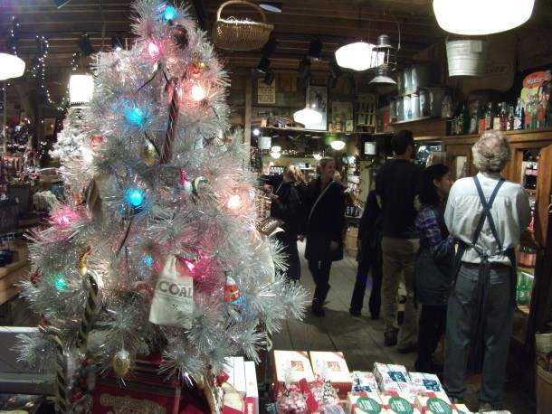 "A '60s era ""tinsel tree"" shines over shoppers at the Vermont Country Store in Weston. VTDigger Photo by Kevin O'Connor."