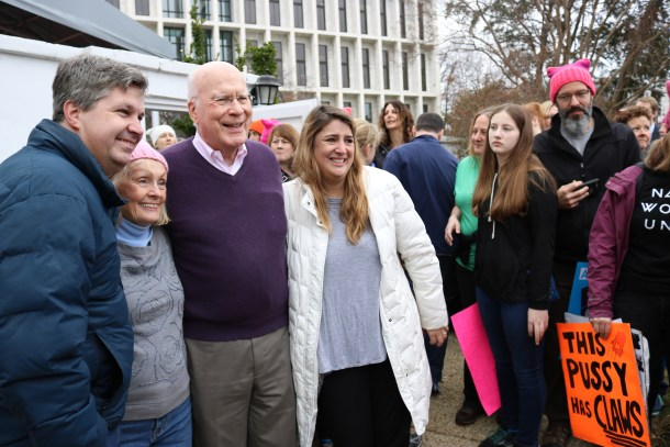 U.S. Sen. Patrick Leahy, D-Vt., and his wife, Marcelle, snapped photos with dozens of Vermont marchers on Saturday morning. Photo by Jasper Craven/VTDigger