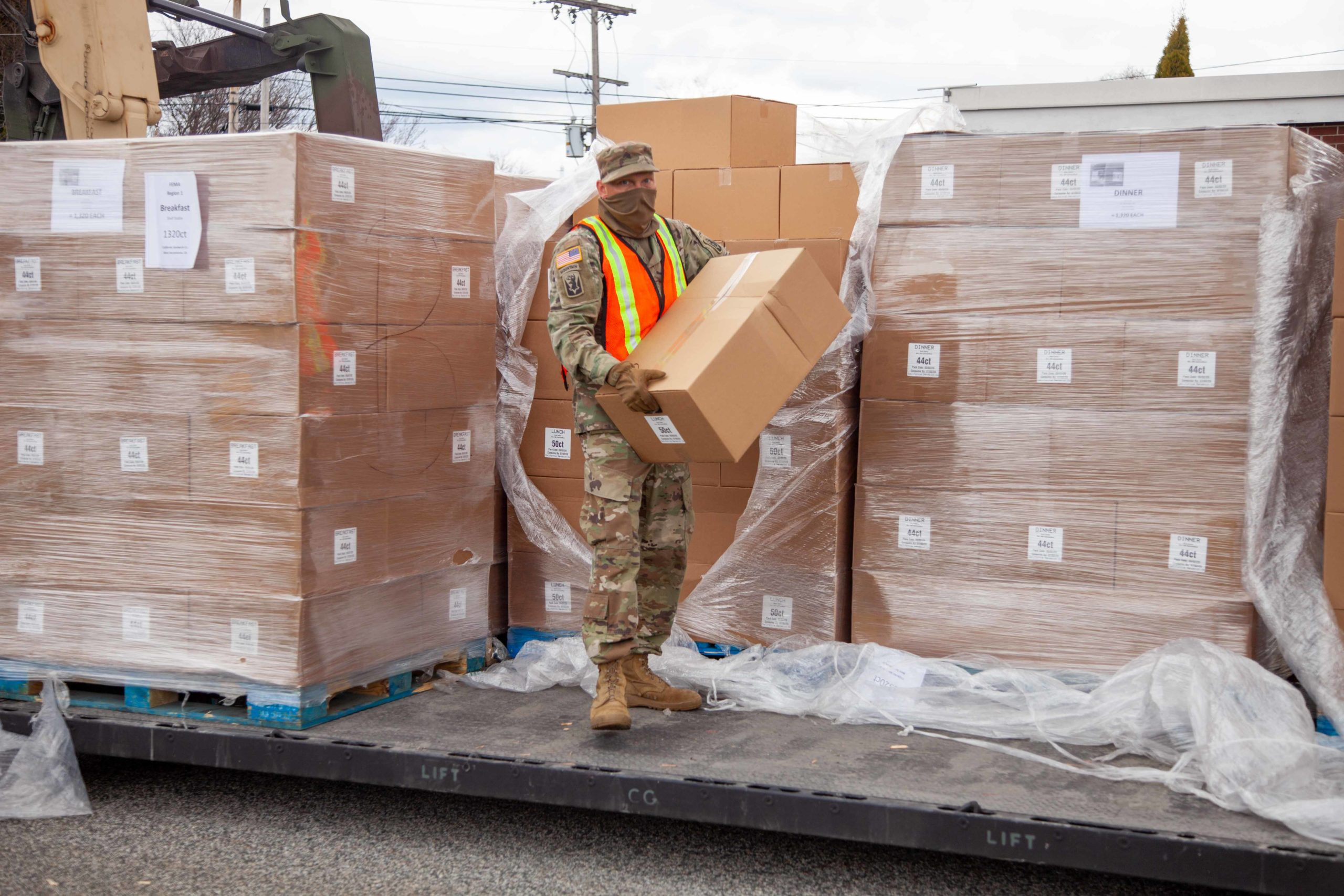 Soldier unloading truck