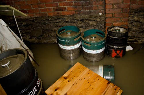 The Three Penny Taproom reportedly lost thousands of dollars worth of beer and goods when flood waters inundated the business' basement. VTD/Josh Larkin