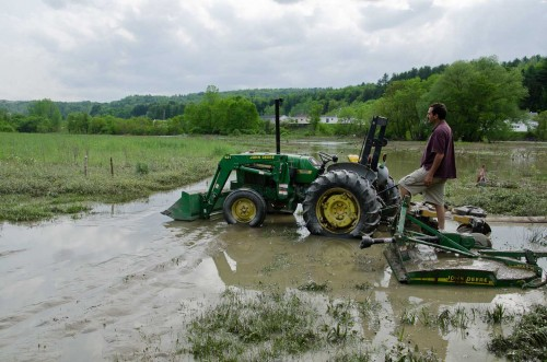 Martin Kemple looks over flooded fields at Foodworks at Two Rivers Farm. VTD/Josh Larkin