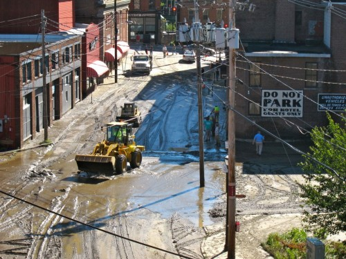 Construction vehicles work to clean up Brattleboro following Tropical Storm Irene.
