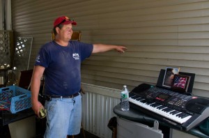Jeffrey Paronto of Graniteville points out the high water mark on the side of a mobile home in Berlin. VTD/Josh Larkin