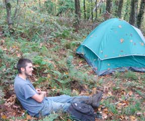 A Sterling College student who chose to identify himself as Bumblebee takes a break after climbing to the campsite. Photo by Chris Braithwaite.