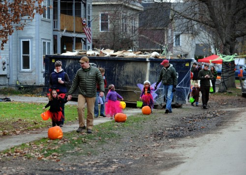 Families trick-or-treat along Randall Street in Waterbury. Photo by Gordon Miller.