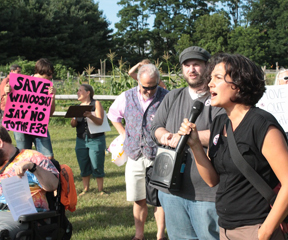 Juliet Buck, a blogger and activist, takes the microphone at a protest outside a Vermont Democratic Party fundraiser on July 19, 2012. Photo by Taylor Dobbs