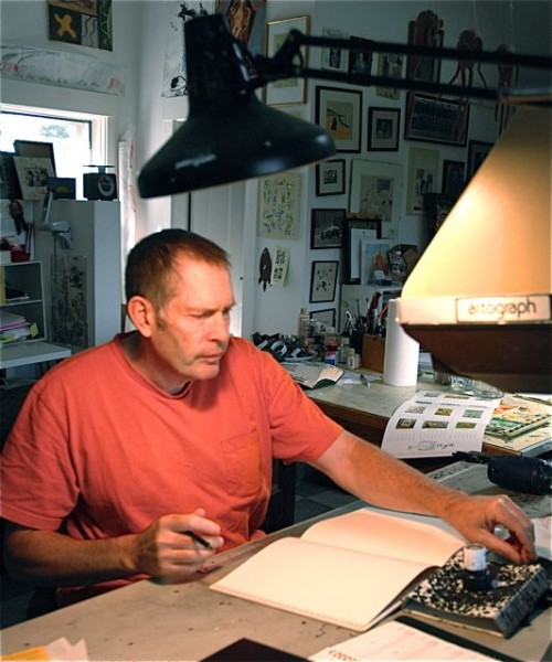Illustrator and cartoonist Hal Mayforth drawing in his sketchbook in his studio in East Montpelier. The ideas Mayforth draws in the sketchbook are key to the creative process for his humorous cartoons and colorful posters and paintings.  Photo by Andrew Nemethy