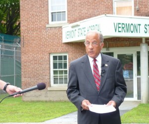 Republican candidate for governor, Sen. Randy Brock, speaks to reporters outside the defunct Vermont State Hospital in Waterbury. Photo by Anne Galloway