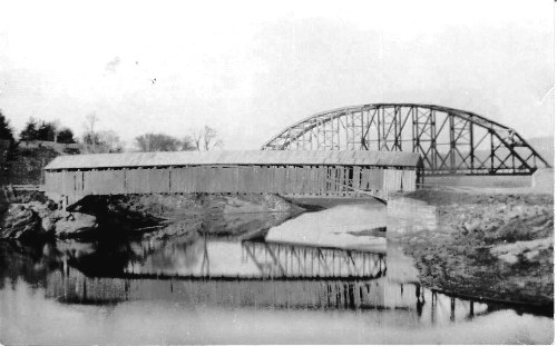 For two years after the Flood of 1927, Richmond's Checkered House wooden bridge sat side by side with the steel bridge being erected to take its place. (Source of photo unknown)